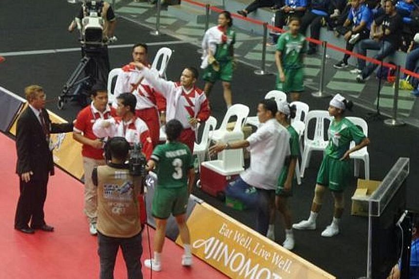 Malaysian badminton player Chan Peng Soon leaves no stone unturned in his bid for gold as the shuttler puts his rackets through some serious testing. No pain, no gain. Indonesia's women's sepak takraw coaches stage a walkout against Malaysia in prote