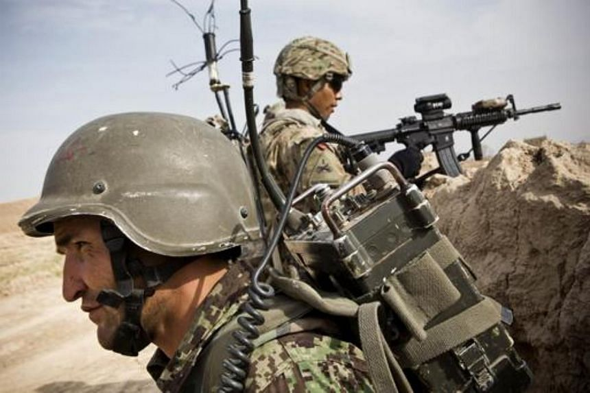 A member of the Afghan National Army during a patrol near Command Outpost AJK (short for Azim-Jan-Kariz, a near-by village) in Maiwand District, Kandahar Province, Afghanistan, on Jan 31, 2013.