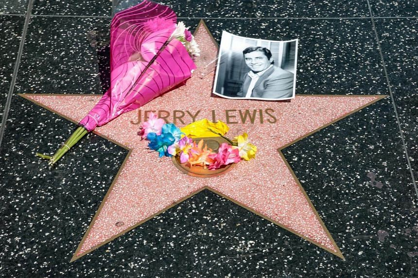 A makeshift memorial appears for late comedian, actor and legendary entertainer Jerry Lewis around his star on the Hollywood Walk of Fame in Los Angeles, on Aug 20, 2017.