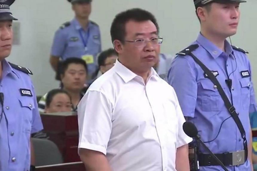 Chinese rights lawyer Jiang Tianyong (centre) appearing in court in Changsha in China's central Hunan province on Aug 22, 2017.