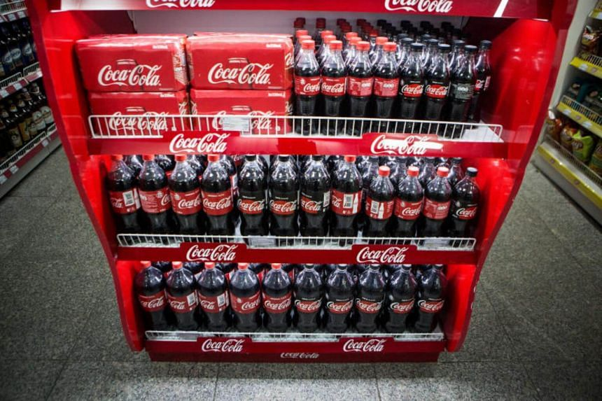 Seven big names in the beverage industry - including Coca-Cola, PepsiCo and F&N Foods - have agreed to cut sugar levels to 12 per cent for all their drinks by 2020.
