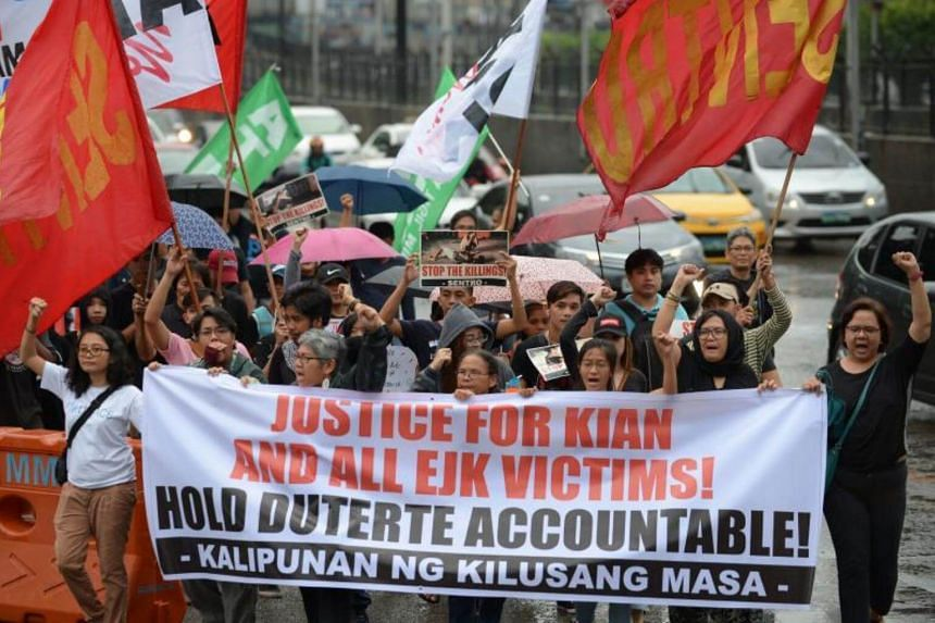 Protesters taking part in a demonstration against the killings of suspected drug users, allegedly by police during anti-drugs raids, in Manila on Aug 21, 2017.