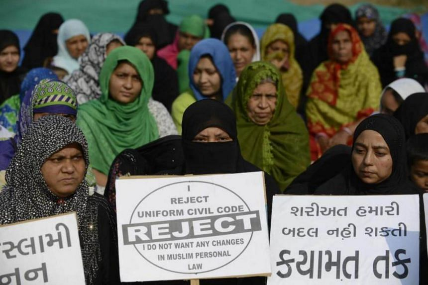Indian Muslim women at a rally to oppose the Uniform Civil Code (UCC) that would outlaw the practice of triple talaq in Ahmedabad.
