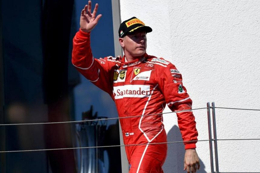 Ferrari's Finnish driver Kimi Raikkonen waves after placing second in the Formula One Hungarian Grand Prix at the Hungaroring racing circuit in Budapest on July 30, 2017.
