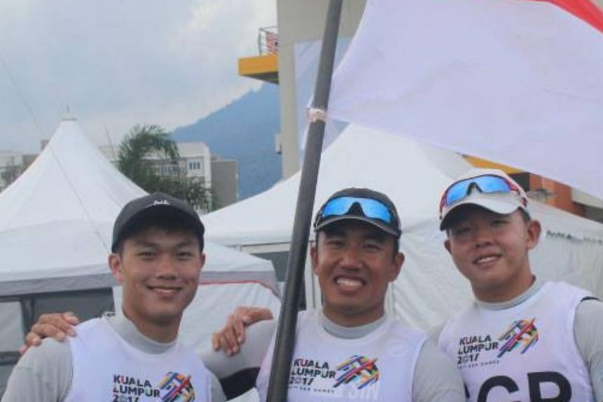 Ryan Lo, Mark Wong and Bernie Chin beat hosts Malaysia in the men's team racing dinghy laser standard finals to clinch the gold medal.
