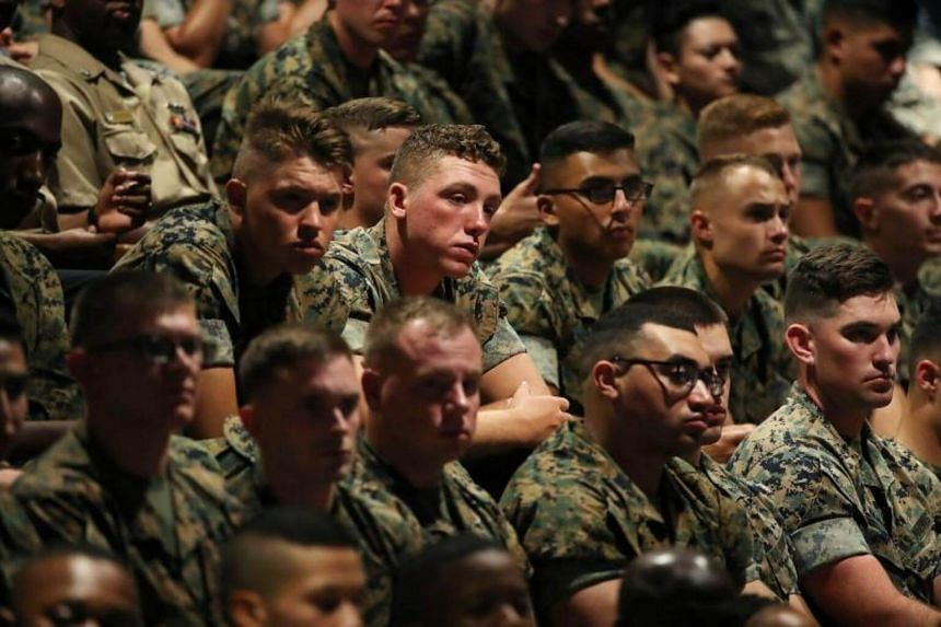 Members of the US military listen to President Donald Trump deliver remarks on American involvement in Afghanistan at the Fort Myer military base in Arlington, Virginia, USA on Aug 21, 2017.