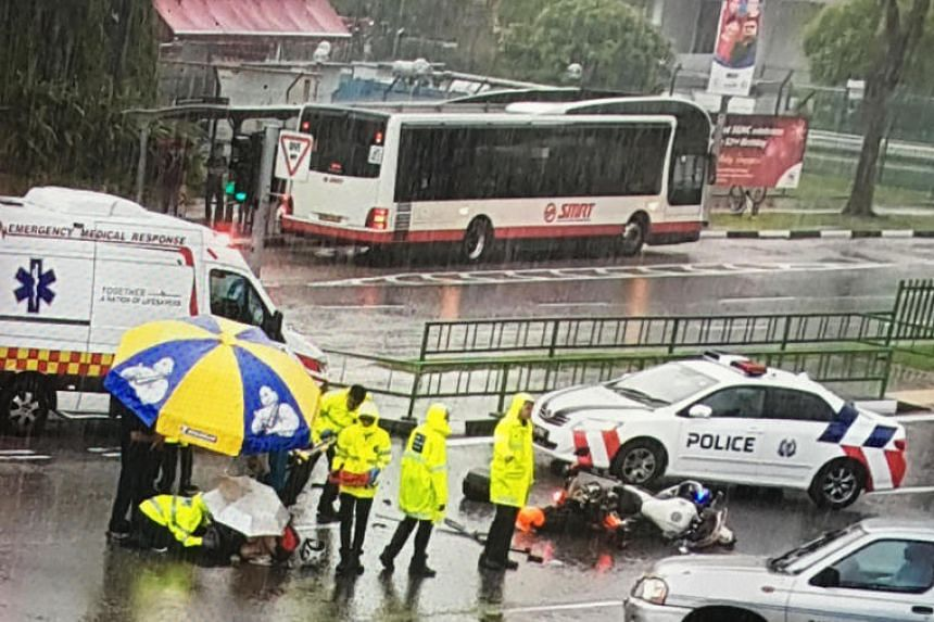 A Singapore Civil Defence Force (SCDF) officer was injured in an accident en route to the scene of a medical emergency on Monday (Aug 21), after a car crashed into the fire bike he was riding. PHOTO: LIANHE WANBAO