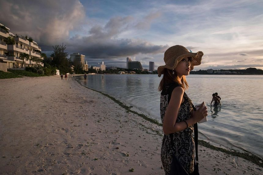 A tourist at a beach at Tumon Bay in Guam on (Aug 12).