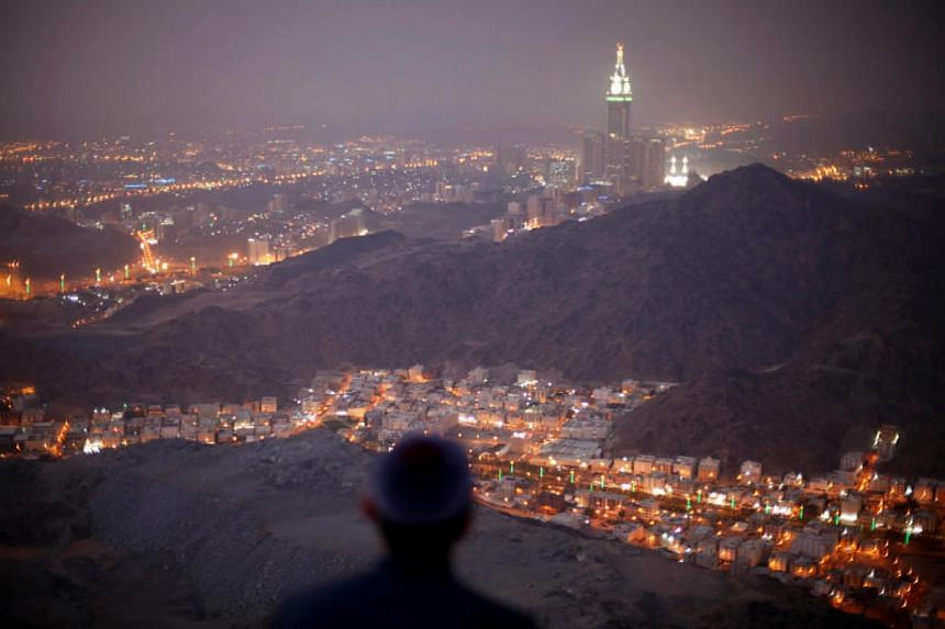 A Muslim pilgrim praying atop Mount Thor in the holy city of Mecca ahead of the annual haj pilgrimage on Oct 11, 2013.