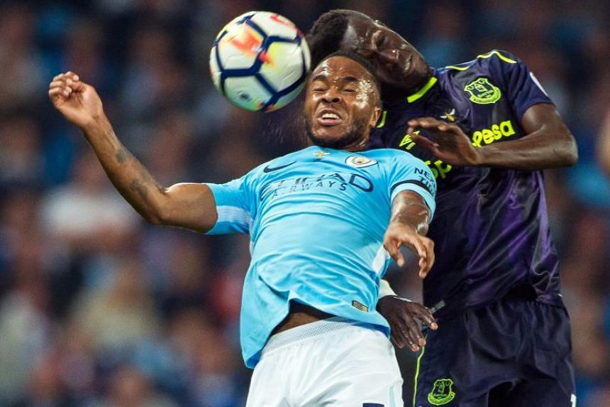 Manchester City's Raheem Sterling (left) in action against Everton's Idrissa Gueye in Manchester on Aug 21, 2017.