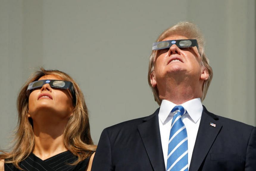 US President Donald Trump and Melania Trump watch the solar eclipse from the White House in Washington, DC on Aug 21, 2017.