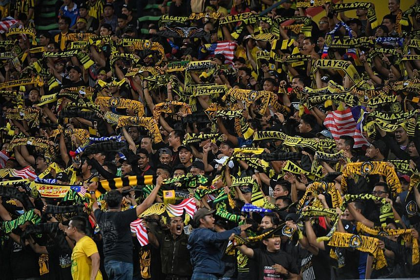 Malaysian fans chanting songs during the SEA Games football match between Singapore and Malaysia, on Aug 16, 2017.