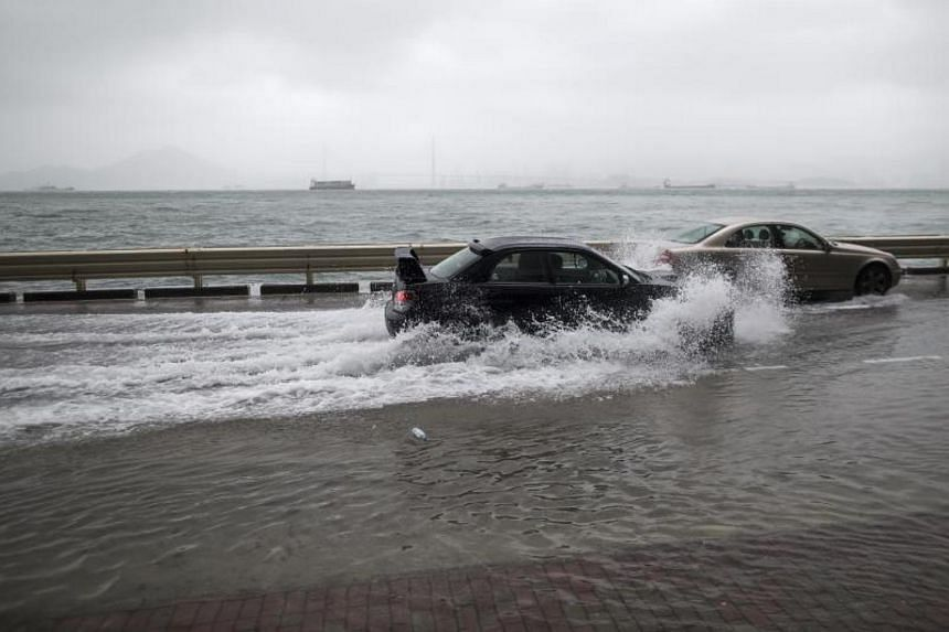 Cars drive on a flooded street as typhoon Hato passes by in Hong Kong, China on Aug 23, 2017.