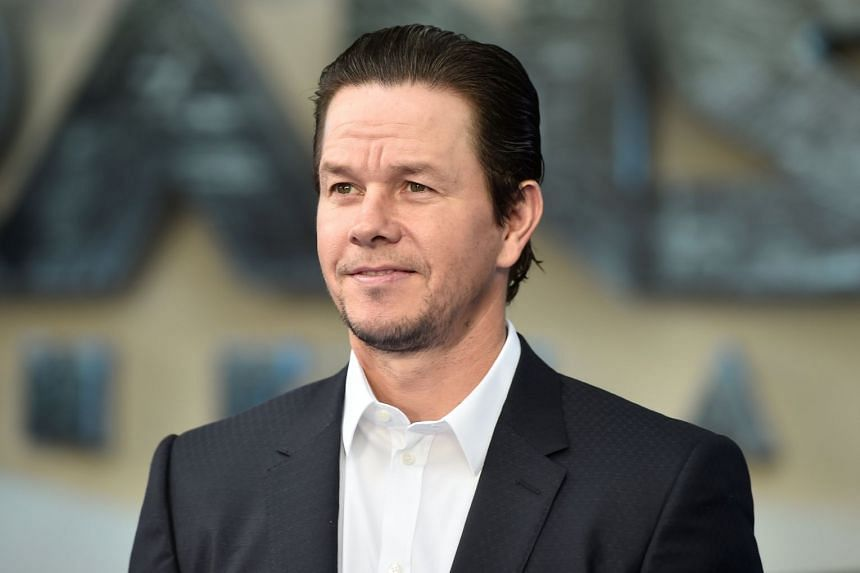 """Rapper-turned-actor Wahlberg (above) knocked 2016 leader Dwayne """"The Rock"""" Johnson into second place."""