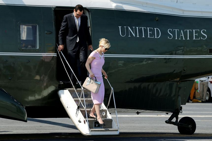 Mnuchin and Linton disembarking from the Marine One helicopter on July 22, 2017.