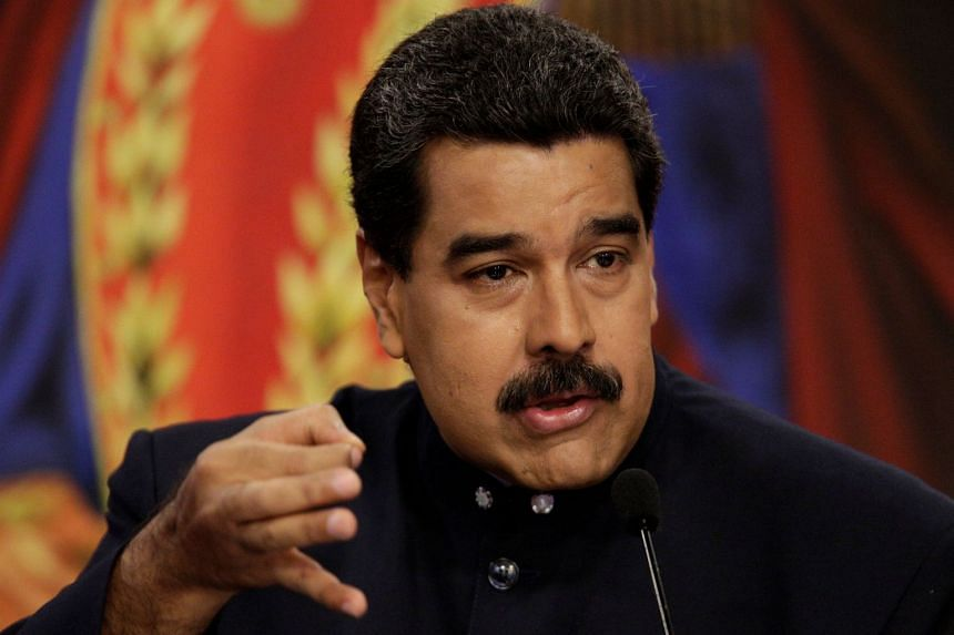 Maduro talks to the media during a news conference in Caracas, Aug 22, 2017.