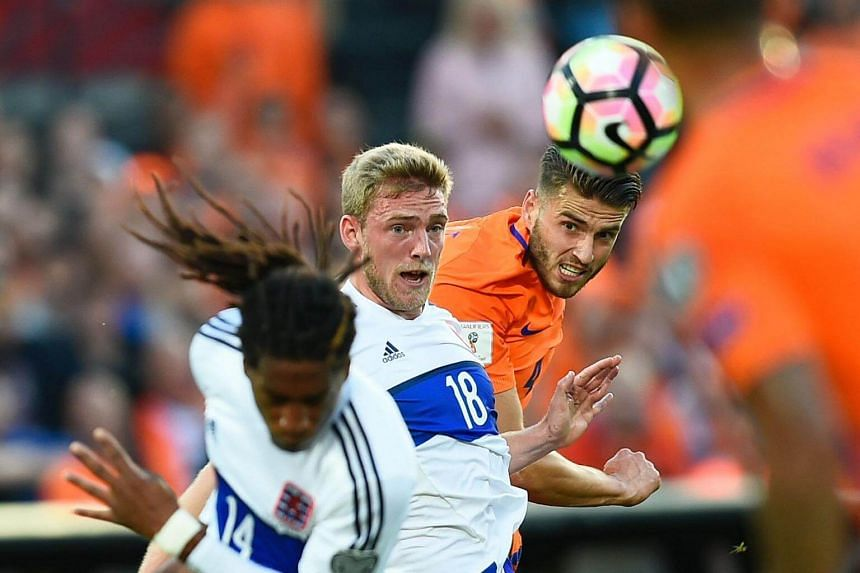 Luxembourg's Laurent Jonas (centre) vies with Dutch's Wesley Hoedt (right) during the Fifa World Cup 2018 qualification football match between Netherlands and Luxembourg in Rotterdam, on June 9, 2017.