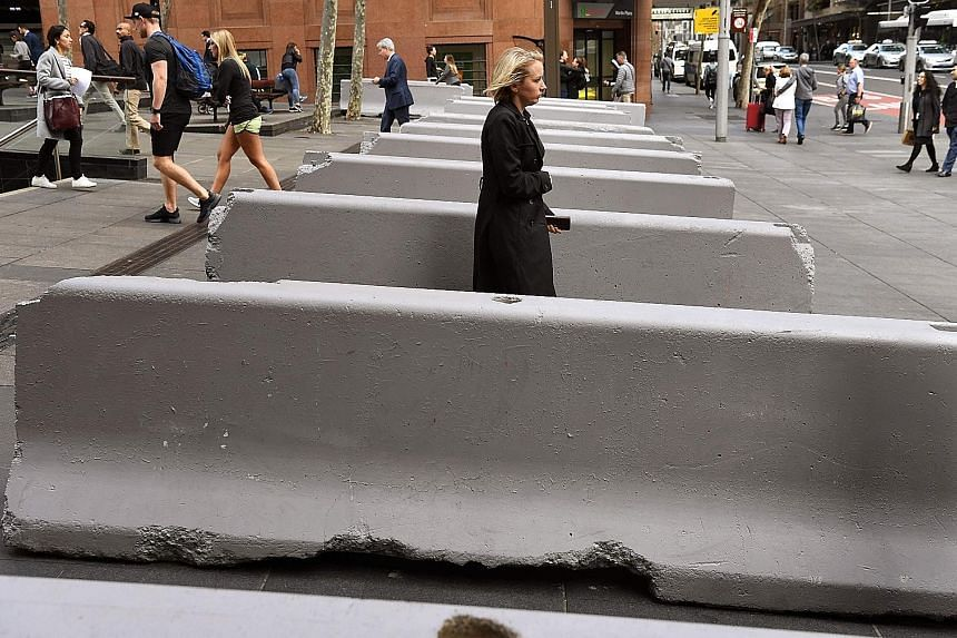 The plan's measures include barriers to prevent vehicles entering pedestrian areas, like these near the Lindt Cafe, the scene of a siege in 2014.