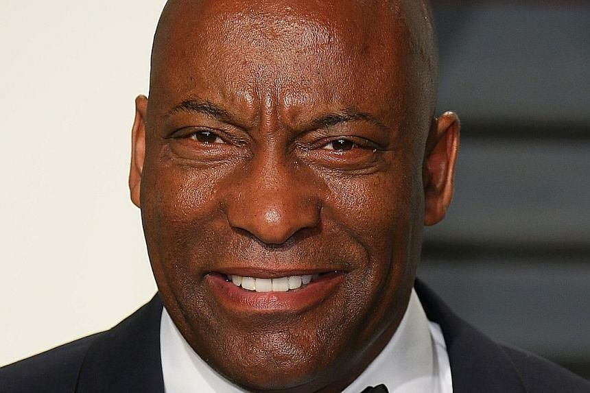 Damson Idris stars as a 19-year-old drug dealer in Snowfall, which film director John Singleton (above) co-created.