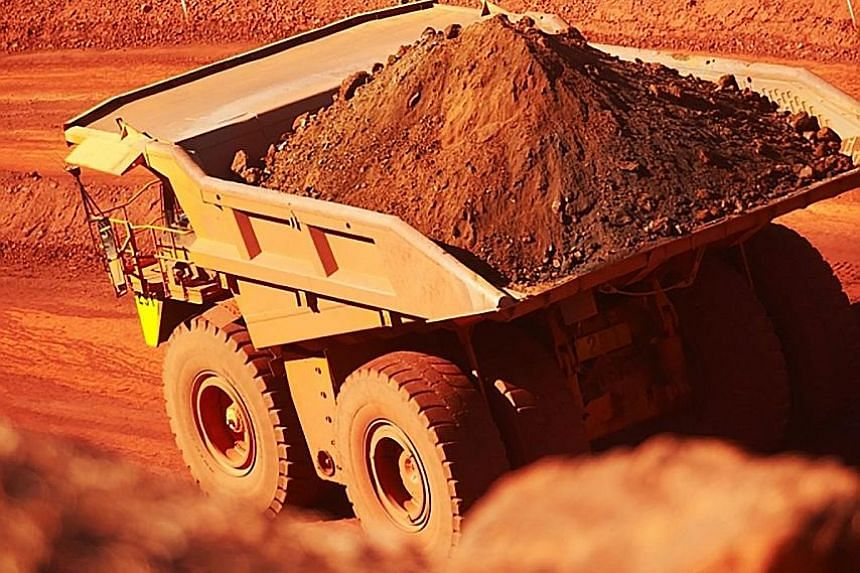 Iron ore being trucked out of a mine at Mount Newman in Western Australia. Miner BHP Billiton reported a surge in profits yesterday on the back of stronger commodity prices.