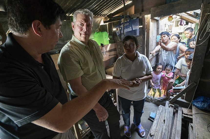 Former United States vice-president Al Gore (second from left) meeting hurricane survivors in Tacloban in the Philippines after Typhoon Haiyan, in a scene from An Inconvenient Sequel: Truth To Power, which Jon Shenk co-directed.