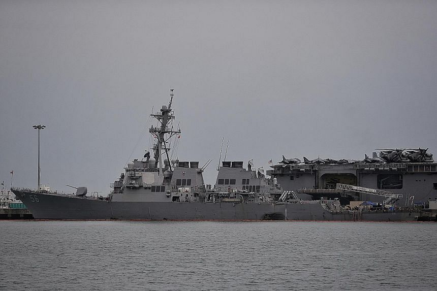 The USS John S. McCain at Changi Naval Base yesterday. The US warship is berthed in Singapore after it sustained serious damage after colliding with an oil tanker early on Monday.