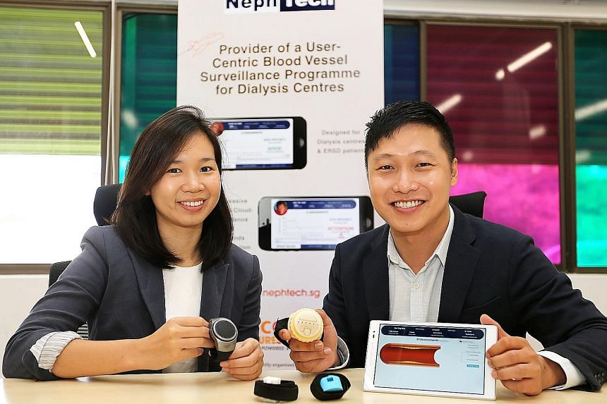 NephTech co-founders Toh Yanling and James Lim, with prototypes of their product - a blood-vessel monitoring device that can be linked to a tablet via Bluetooth.