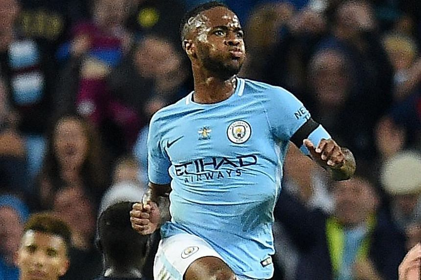 Manchester City's Raheem Sterling celebrates his late equaliser against Everton.