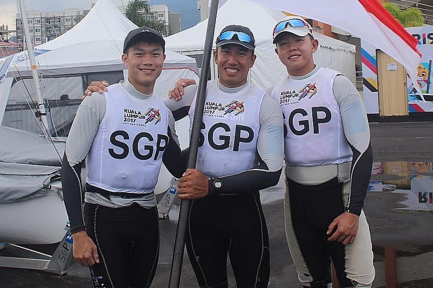 (From left) Bernie Chin, Mark Wong and Ryan Lo teamed up to win the Laser Standard, beating the experienced Malaysian sailors 2-0 in the final after a 1-1 round-robin tie.