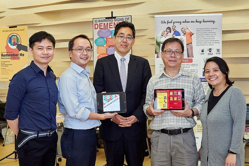 Mr Chew Khoon Hong (second from right) and MindWorks developers (from left) Dr Chee Chew Sim, Mr Sam Sim, Professor Ryuta Kawashima and Ms Shereen Pong showing the free Android games. Mr Chew is one of the seniors who tested the brain-training games,