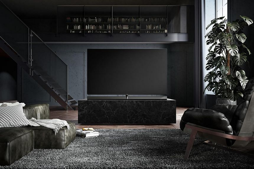 The TV stand for Panasonic's TH-65EZ1000S is designed to lift the screen in order to fit a massive sound bar that is as wide as the TV set underneath it. The TV set can also be mounted on the wall.