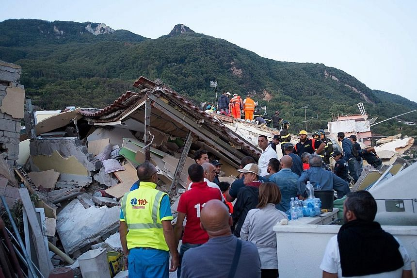 An earthquake hit the tourist-packed Italian holiday island of Ischia, killing at least two people, injuring dozens of others and trapping three young brothers in the rubble. Many tourists and residents on the island off the coast of Naples fled afte