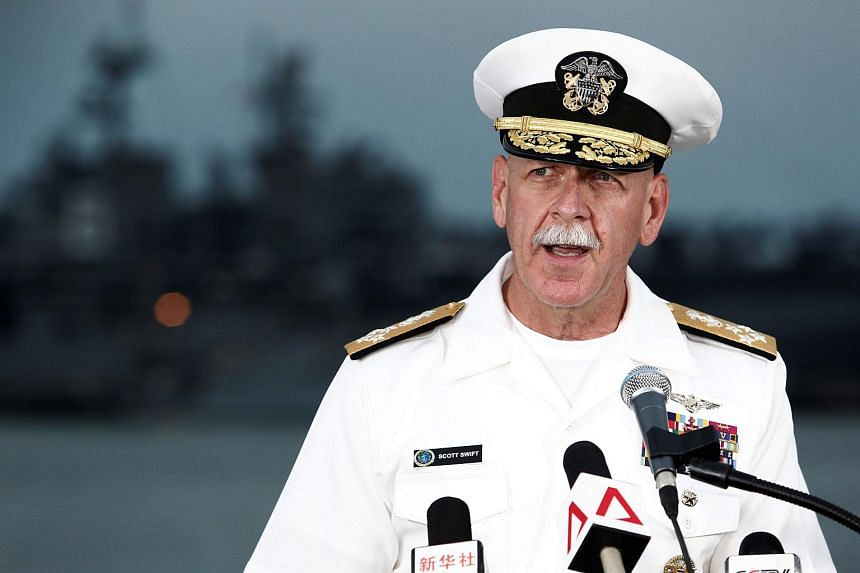 Admiral Scott Swift, Commander of the US Pacific Fleet, speaks at a news conference near the damaged USS John McCain and the USS America at Changi Naval Base.