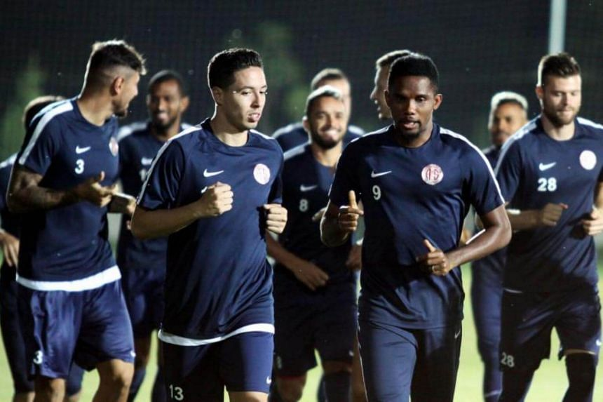 Antalyaspor's new French midfielder Samir Nasri (left) runs next to Antalyaspor's Cameroonian forward Samuel Eto'o during his first pratice session after his signing ceremony in Antalya, on Aug 22, 2017.