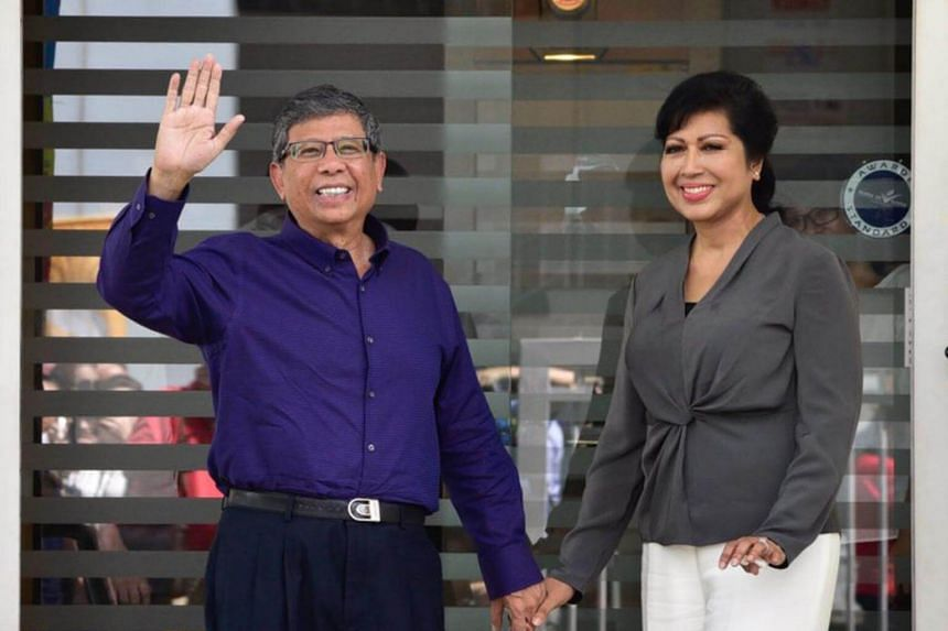 Presidential hopeful Salleh Marican and his wife at the Elections Department on Aug 23, 2017.