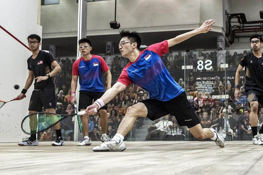Mohammad Syafiq (right) and Ng Eain Yow (left) of Malaysia and Pang Ka Hoe (second right) and Timothy Leong Yew Sing of Singapore in action during the SEA Games 2017 Men's Squash doubles final event in Kuala Lumpur, Malaysia on Aug 23, 2017.