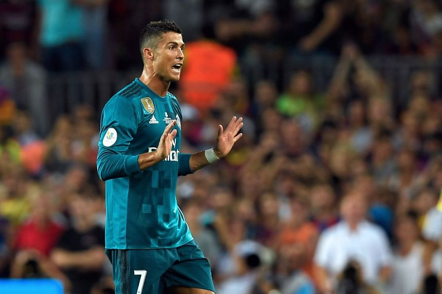 Ronaldo leaves the field after receiving his second yellow card during the Spanish Supercup.