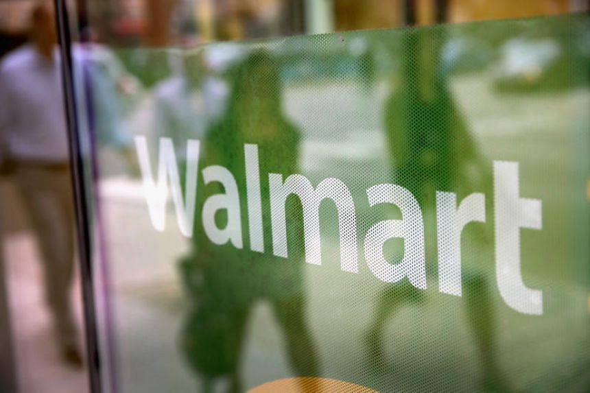 The Wal-Mart logo is displayed in the window of a Walmart Neighborhood Market store in Chicago.