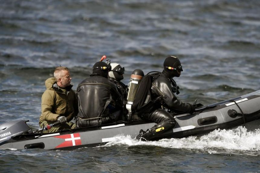 Divers from the Danish Defence Command preparing for a dive in Koge Bugt near Amager in Copenhagen on Aug 22, 2017 where a woman torso was found yesterday.