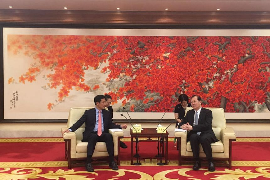 Mr Ong Ye Kung (left) meets with Guangzhou party chief Ren Xuefeng on Wednesday.