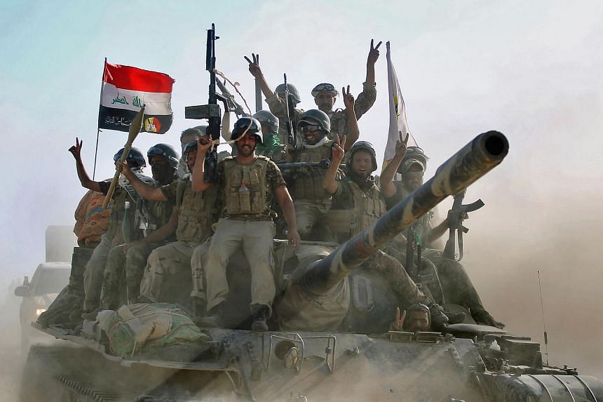 Fighters of the Hashed Al-Shaabi advance towards the town of Tal Afar, west of Mosul, after the Iraqi government announced the beginning of the operation to retake it from the control of ISIS.