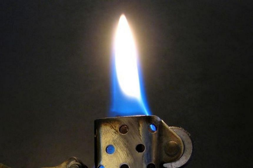 A drunk man was badly burnt after he set off a lighter in his pocket at the Jelapang police station in Malaysia.