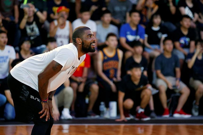 Kyrie Irving, reacts during a promotional event in Taipei.