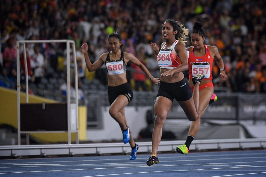 Shanti Pereira crosses the line in third place during the SEA Games women's 200m final on 23 August, 2017.
