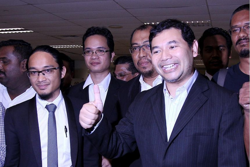 The Malaysian High Court on Wednesday (Aug 23) upheld the 18-month jail sentence meted out to Malaysian opposition MP Mohd Rafizi Ramli (right, in a file photo) for exposing a page of the audit report on embattled state fund 1Malaysia Development Bhd