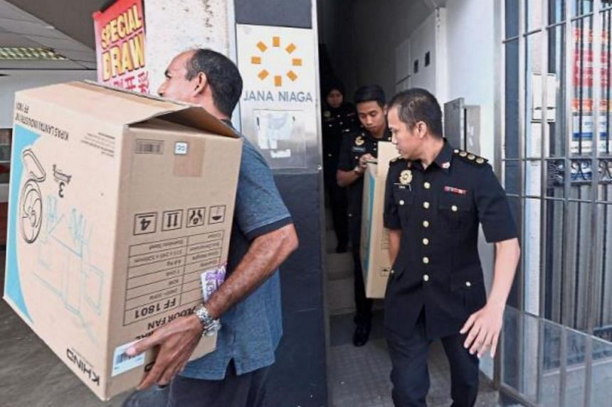 Under investigation: MACC officers leaving the Jana Niaga office in Desa Pandan after the raid. Jana Niaga was responsible for maintenance work on student accommodations at the Unisel main campus in Bestari Jaya.
