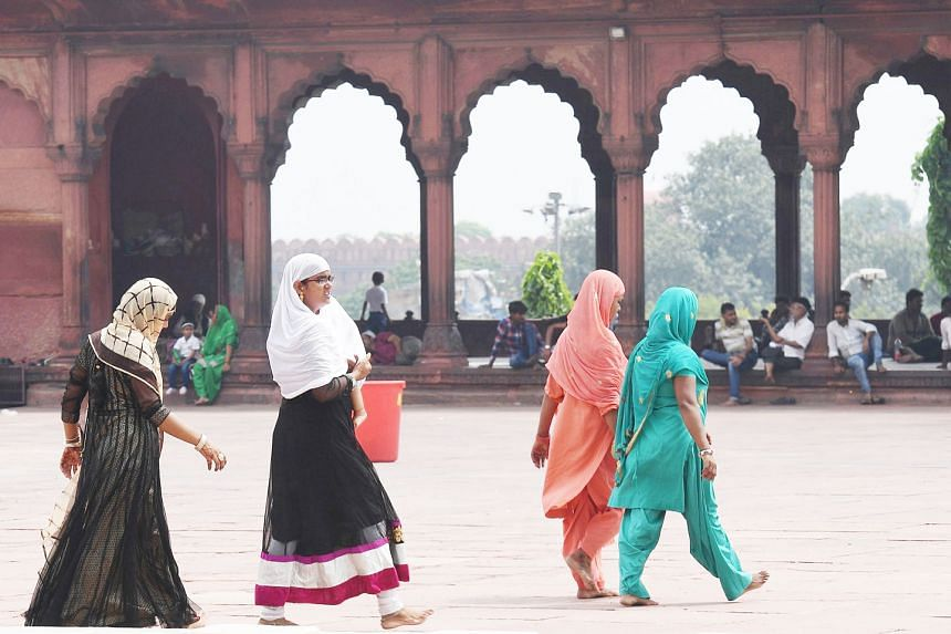 Indian Muslim women on their way to the Jama Masjid in New Delhi yesterday. The Supreme Court ruling ends a long tradition that many Muslim women had fiercely opposed.