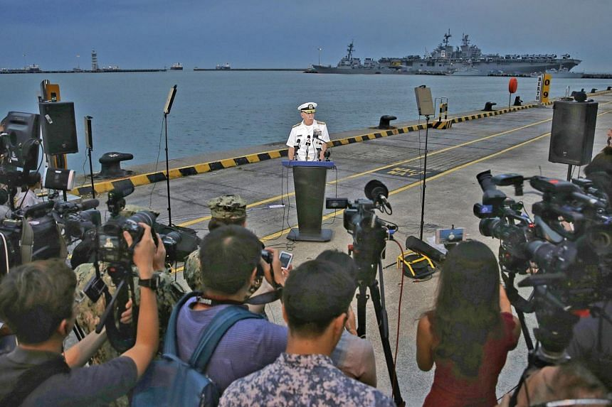 Admiral Scott Swift, commander of the US Pacific Fleet, speaking to the media at Changi Naval Base yesterday. The damaged USS John S. McCain can be seen in the background. On possible causes of the accident, he said nothing has been ruled out, includ