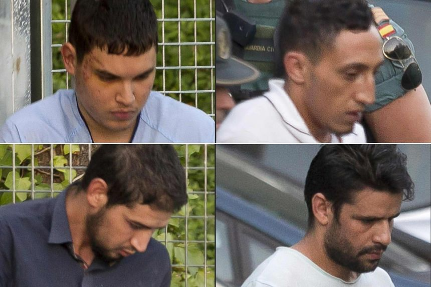 (From top left, clockwise) Suspects Mohamed Houli Chemlal, Driss Oukabir, Mohamed Aallaa and Salah El Karib being taken from a detention centre near Madrid yesterday before being transferred to the National Court, which deals with terrorism cases.