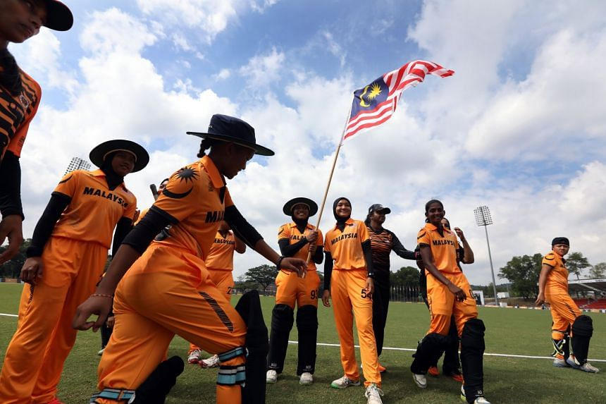 The Malaysian women's cricket team celebrate beating Singapore by nine wickets in their T20 match at the SEA Games in Kuala Lumpur on Aug 23, 2017.